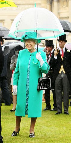 While hosting a garden party in 2011, the Queen matched her bright mint coat and hat with her must-have accessory, an umbrella.