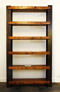 Gorgeous bookshelf with reclaimed wood shelves and reclaimed steel i-beam supports: