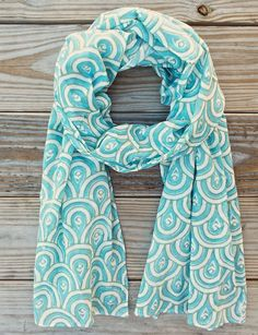 """We call this print """"the peacock"""" and who doesn't love peacocks! This light-weight cotton hand block printed teal scarf is one of our best sellers, an easy way to dress up a white t-shirt. Fair trade. Eco dyes."""