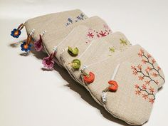 Embroidered zip pouches on Etsy