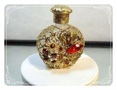 Vintage rhinestone filigree perfume bottle