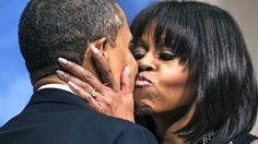 MUUUUUAH! President Barack Obama is kissed by First Lady Michelle Obama during his inauguration reception at the National Building Museum January 20, 2013 in Washington, DC