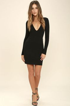 The Fun and Fame Black Long Sleeve Bodycon Dress is a game changer! Medium-weight knit creates a fitted look over a plunging V-neck, and long sleeves with lightly padded shoulders. Side darting and bodycon skirt. Hidden back zipper.