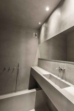 GEM Architects converted the eclecticism of the former decoration of this apartment located in a northern suburb of Athens into pure #minimalism #bathroom
