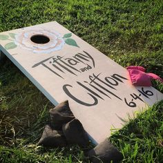 Such a cool idea for wedding fun -- corn hole for the guests at the reception! And the board is decorated in honor of Tiffany and Clifton's special day. #cornhole #cornholeboards #wedding #weddingvideo #weddingmovie #rva #rvawedding #varina #rvabride