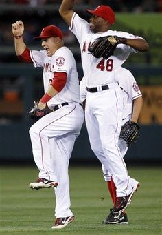 Game #94 7/20/12: Los Angeles Angels center fielder Mike Trout, left, leaps with Angels right fielder Torii Hunter (48) to celebrate defeating the Texas Rangers 6-2 in a baseball game in Anaheim, Calif., Friday, July 20, 2012. (AP Photo/Alex Gallardo)