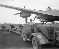 Rare female contribution on the German side: Work of WAAF at bomber stations: motor transport driver at the wheel of a tractor that has towed the bomb train.Avro Lancaster in the background. Military Helicopter, Military Aircraft, Tractor Pictures, Lancaster Bomber, Ww2 Pictures, Military Women, Ww2 Women, Vintage Tractors, Ww2 Aircraft