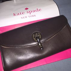 Authentic Kate spade brown leather wallet In great condition , couple scratches on leather but inside as you see in pics is in wonderful condition. kate spade Bags Wallets