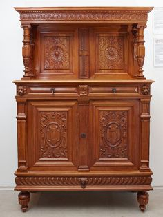 French Renaissance-style carved Grenoble walnut credenza, with initialed front doors and the year 1864 carved on the front of the upper section.