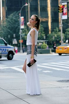 Polish blogger Karolina aka Charlize Mystery wore Louis Vuitton jewelry and a black leather clutch on the streets of #NYFW.