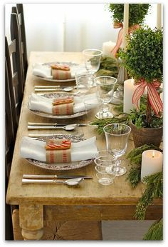 Christmas Table Setting, rustic farm table, greens, topiaries, burlap napkin ties