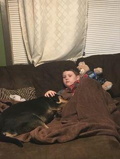 Cooper taking care of his sick brother 3-12-16  Pneumonia :(