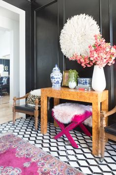Home Decorating DIY Projects : How to Use a Juju Hat in Home Decor black painted wainscoating black walls entryway burl wood table entryway console table styling black and white marble floor leopard pillows -Read More –