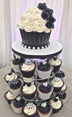 Black & white wedding cupcake tower with giant cupcake top cake