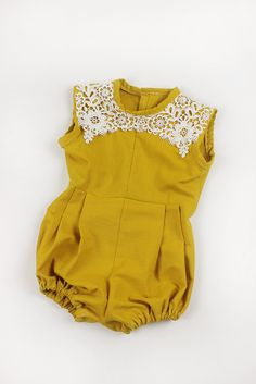 **If you need your order by a certain date, please contact me before placing your order.  *Link to long sleeve- https://www.etsy.com/listing/385889596/baby-girl-clothes-baby-girl-romper?ref=shop_home_active_1  Gold mustard and baby blue baby girl romper with lace collars! Great for everyday wear, special occasions, or a photoshoot! Made with 100% cotton, lace, and elastic. Available sizes: 3-6 M 6-12 M 12-24 M 2/3T 4/5T 6/7 8/9  *listing has been updated due to some material changes. If you…
