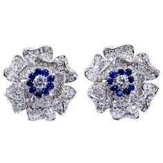 Diamond Sapphire Tudor Rose Flower Earclips | From a unique collection of vintage clip-on earrings at http://www.1stdibs.com/jewelry/earrings/clip-on-earrings/