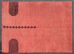 Ivan Da Silva Bruhns | | A rare, large knotted wool carpet with a geometrical decoration of black circles on a red background | Circa 1930 | 145 2/3 x 114 ¼ in
