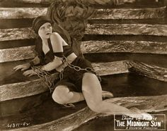 1926: Laura La Plante, shackled and captive awaiting the death wave in a scene from the film 'The Midnight Sun', directed by Dimitri Buchowetzki for Universal