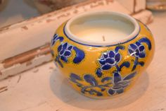 Candle in a blue and yellow jar