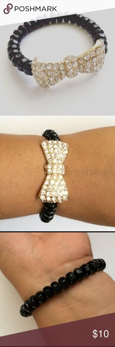 Bow Bracelet Fashion statement bracelet. Get your black beads bracelet with gold tone rhinestones and more. Stretchable band and perfect for summer. Any questions let me know. NO TRADES. Hit me a reasonable offer. See pictures for better description. Jewelry Bracelets