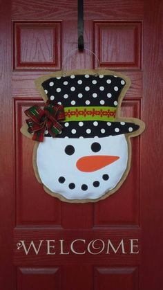 Winter Burlap snowman. Perfect addition to your front door all holiday season and beyond! Measures 24 H by 22W.