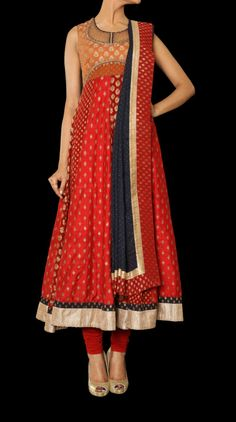 A beautiful sleeveless anarkali with a matching churidar and blue color net dupatta. http://www.ritukumar.com/a-suit-from-arjuna-range-by-ritu-kumar-with-red-color