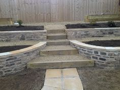 Retaining walls in natural stone, sleeper steps, garden design by G.K.Wilson Garden Services Ltd http://www.gardensandlandscapes.co.uk