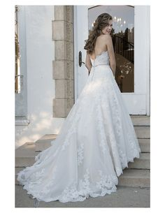 Check out the back of this beautiful drop waist ballgown, available at Spotlight Formal Wear! #SpotlightBridal