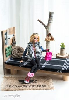 This Barbie's bed > my bed. Get the tutorial here, and get a tour of this awesome DIY house here.