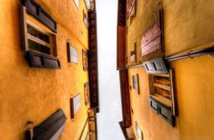 shutters houses yellow italy looking up