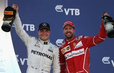 Race winner Valtteri Bottas of Finland and Mercedes GP celebrates with second placed finiser Sebastian Vettel of Germany and Ferrari on the podium during the Formula One Grand Prix of Russia on April 30, 2017 in Sochi, Russia.