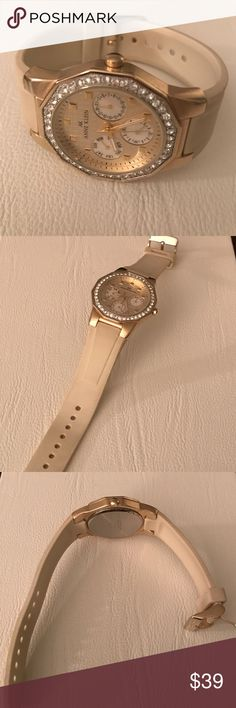 Anne Klein Watch Anne Kleni crystal bezel, rubber tan band watch.. Super cute - band shows some wear but still in good condition. No scratches on the glass.. **Just needs battery** Anne Klein Accessories Watches