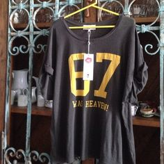 """OVERSIZED TEE BY WILDFOX Details: Says: """" 67 was Heaven!"""" in yellow on dark gray background.  Scoop neck; sleeves are rolled with stitching 90% Cotton, 10% Poly Size S (Fits many) Measurements:  25"""" from top to bottom of hem, 19"""" from pit to pit Retails:  $77.00, NWT (Made in USA) Wildfox Tops Tees - Short Sleeve"""