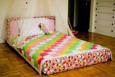 Cute little floor bed.