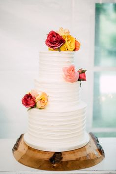 Colorful floral topped cake: http://www.stylemepretty.com/canada-weddings/2016/04/22/southern-rustic-wedding-in-toronto-canada/ | Photography: Simply Lace - http://www.simplylacephotography.ca/
