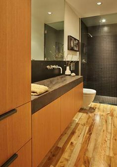 """The long, cast-concrete sink in the powder room was crafted by Brian Decker. """"Here you had this problem; it was a long, skinny bathroom,"""" Rerucha says. """"And here you add this sink; it's a problem turned into something interesting."""""""