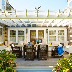 Our 20 Best Outdoor Decorating Tips Ever | Whether it's winter or summer, spring or fall, living on the coast is practically a license to live outdoors. Does your alfresco space stack up? Here are 20 designer-backed secrets to pump up the pretty on your porch, patio, deck, or backyard.