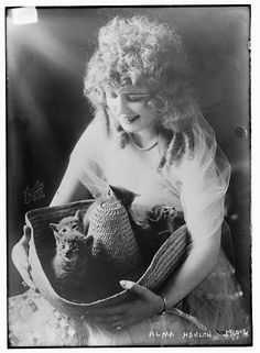 Silent film actress Alma Hanlon and kittens, Library of Congress Prints and Photographs Division Washington, D.C.