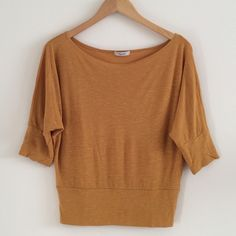 Mustard Dolman Top Breezy deep yellow slightly sheer dolman top with wide neckline, half sleeves, and banded hem. No size or material tags, but it fits like an S and has a linen-rayon blend texture. In good used condition. teenbell Tops