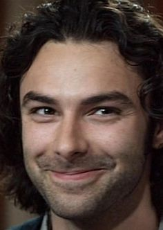 Aidan Turner and the cute little impish smile of his *.*