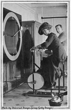 Passengers using 'cycle racing machines' in the gymnasium on board the Titanic, 1912.