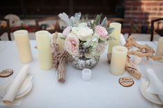With brighter colors for the flowers and maybe floating candles surrounding the centerpiece in varying heights of vases.