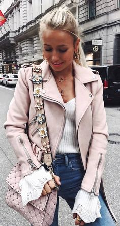 cool outfit / floral bag + biker jacket + white top + jeans