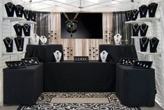 Booth Set-up by Cindi Hendrickson.  Tent sides are on tent, but the drapes and flooring add the touch of sophistication.