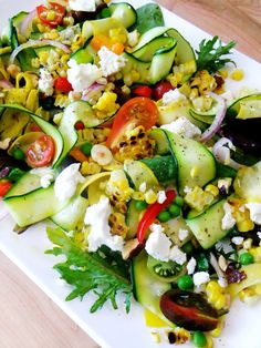 Squash and Zucchini Ribbon Salad with Tomatoes, Peas, Corn, and Goat Cheese