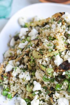 Plate of quinoa, feta & grilled zucchini salad close up