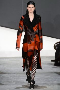 Wonderfully, the designers allowed the natural pattern of the skins to shine through, even though they either dyed them red or heightened their natural brown-white or black-white color contrasts. Regardless, two calf hair coats, one red, one brown, turned heads.   - HarpersBAZAAR.com