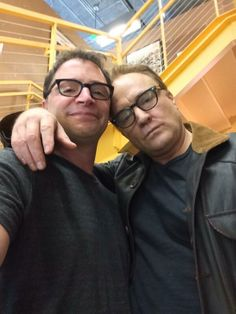 The former West Wing cast members are required to all wear dark framed glasses now. (Josh Malina & Bradley Whitford)