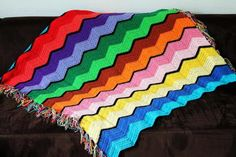 Retro Rainbow Ripple Crochet Afghan - add color to your home with some rainbow ripple stitches!