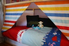 This is a photo of my boys' bedroom hideout. Ikea Kura bed + homemade curtains attached with Velcro home décor strips.